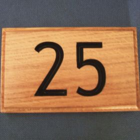 Choose to have your numbers painted after they are carved to help them really stand out.
