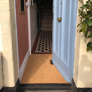 If you place a barrier between PVC backed matting the matting and the floor, it's can be used with underfloor heating in a mat well.